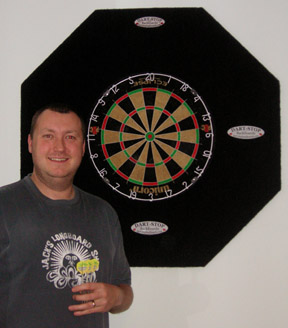 "Wayne ""Hawaii 501"" Mardle at home with his practice Dart-Stop backboard"
